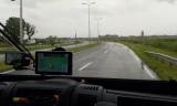 In de regen...