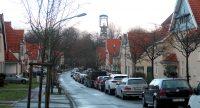 Mijnkolonie Teutoburgia bij Herne (Essen). Op de achtergrond de oude schachtbok, een lifttoren.
